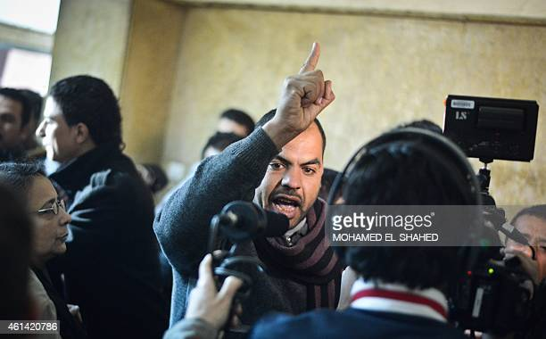 Family members react at an Egyptian court in Cairo following the acquittal on January 12 2015 of 26 male defendants accused of 'debauchery' after...