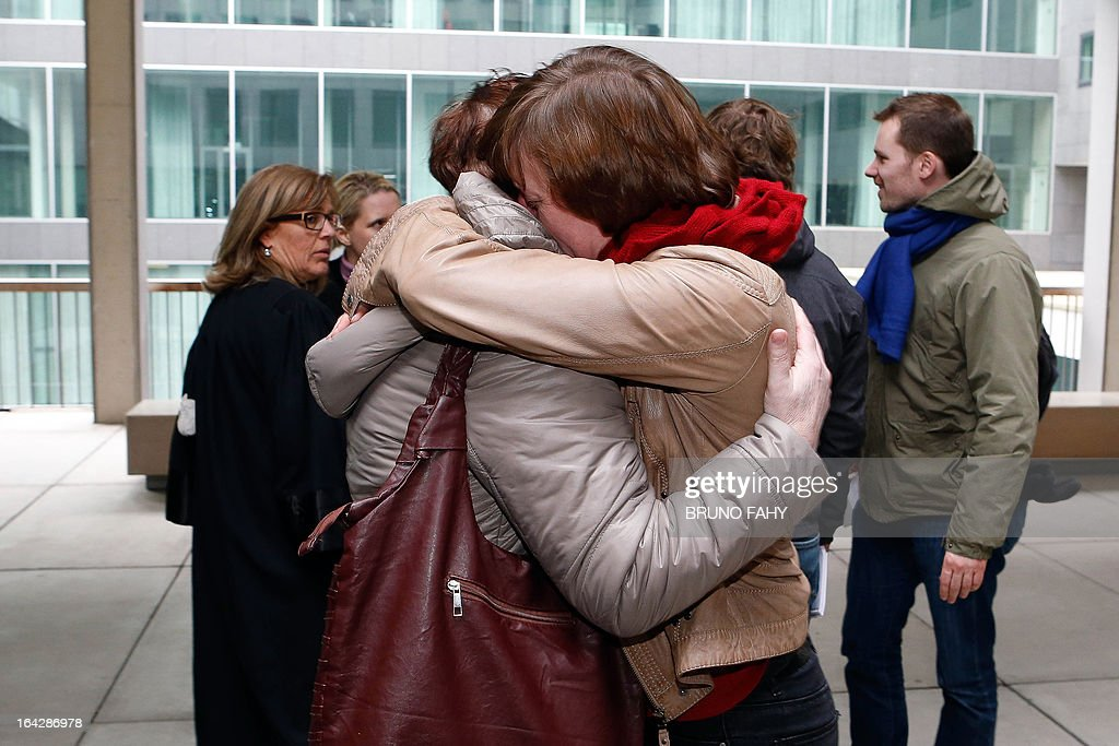 Family members react on March 22, 2013 at the Gent courthouse, after 24-year-old child killer Kim De Gelder was found guilty of the murder of four people including two infants. Gelder was found guilty of killing two infants aged six and nine months and their 54-year-old carer in an attack on the Fable Land nursery in the town of Dendermonde in January 2009. The court ruled out mental illness in its verdict. Belgium Out