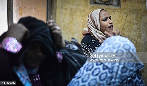 Family members react outside an Egyptian court in Cairo following the acquittal on January 12 2015 of 26 male defendants accused of 'debauchery'...