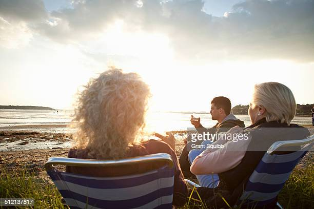 Family members relaxing by beach