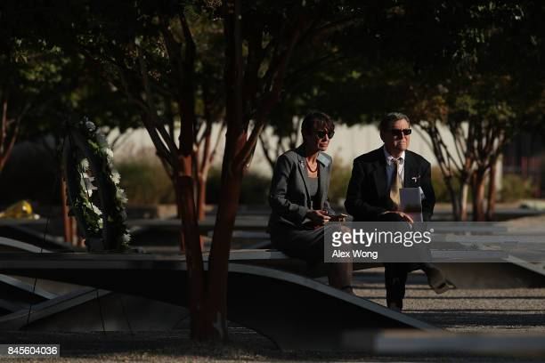 Family members remember their love one prior to an observance to commemorate the anniversary of the 9/11 terror attacks at the Pentagon Memorial...
