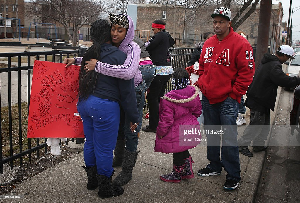 Family members visit a memorial to eighteen-year-old Frances Colon near the spot where she was murdered on February 18, 2013 in Chicago, Illinois. Colon, who was shot February 15th while walking by the neighborhood play lot, was the 51st person murdered in Chicago in 2013. She was the third student from Roberto Clemente High School, a Westside school with less than 800 students, to be murdered in the past three months.