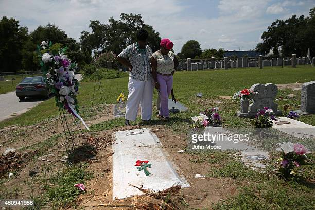 Family members visit the grave of Ethel Lance one of the nine victims of a mass shooting on July 15 2015 at the Emanuel Methodist Episcopal Church in...
