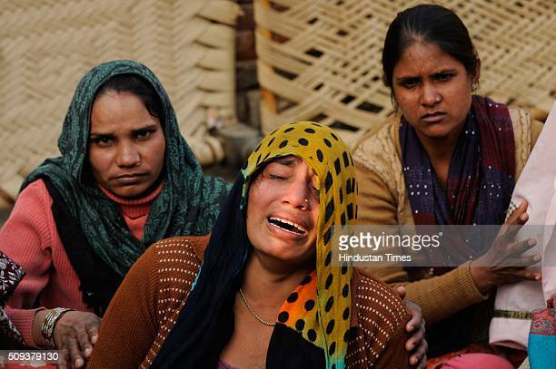 Family members wailing after the murder of a 55yearold dalit man over property dispute at Kambakshpur Village on February 10 2016 in Greater Noida...
