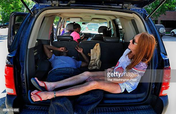 Family members wait in a hot car in the parking lot of the cancer treatment center during the 5hour chemo therapy session for Troy Williams In...