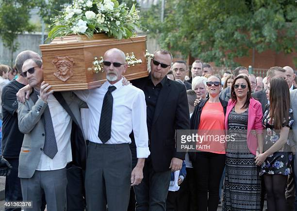 Family members walk behind the coffin of Gerry Conlon as it is carried from his home in west Belfast on June 28 2014 Conlon who wrongly spent 15...
