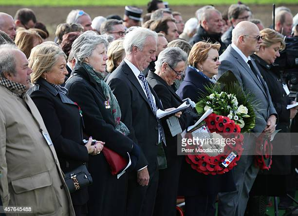 Family members watch a reburial ceremony at the Commonwealth War Graves Commission YFarm Cemetery on October 22 2014 in BoisGrenier France The...