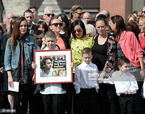 Family members watch as the coffin of Gerry Conlon is carried into St Peter's Cathedral for a requiem mass on June 28 2014 in Belfast Northern...
