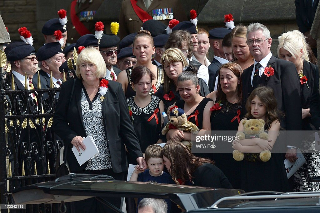 Family members watch as the coffin of murdered Fusilier Lee Rigby is carried to the hearse from Bury Parish Church following the funeral service on...