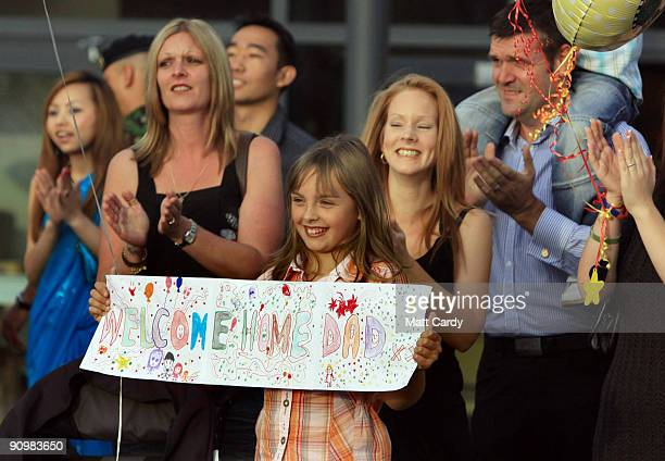 Family members welcome home soldiers from the 33 Armoured Engineer Squadron at Swinton Barracks Perham Down on September 20 2009 in Tidworth England...