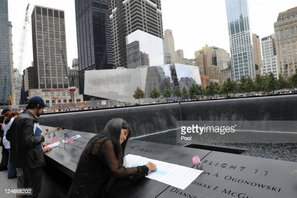 Family members who lost loved ones attend the memorial during tenth anniversary ceremonies of the September 11 2001 terrorist attacks at the World...