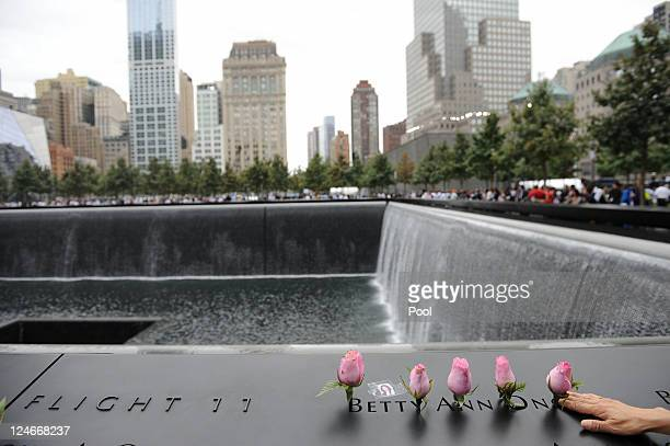 Family members who lost loved ones bring flowers to the memorial during tenth anniversary ceremonies of the September 11 2001 terrorist attacks at...