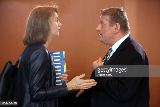 Family Minister Katarina Barley and Health Minister Hermann Groehe arrive for the weekly German federal Cabinet meeting on June 28 2017 in Berlin...