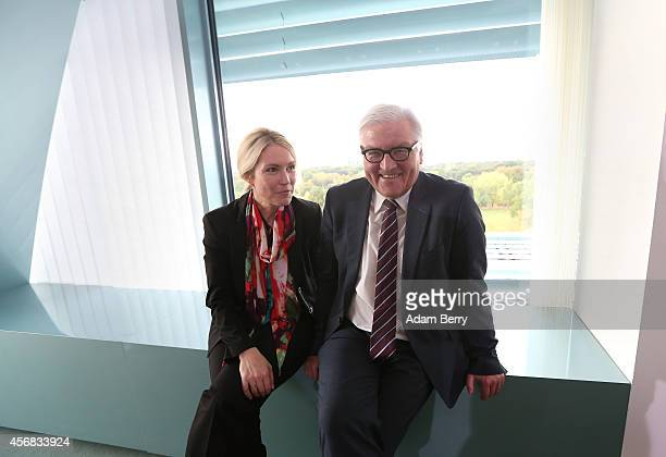 Family Minister Manuela Schwesig and Foreign Minister FrankWalter Steinmeier arrive for the weekly German federal Cabinet meeting on October 8 2014...