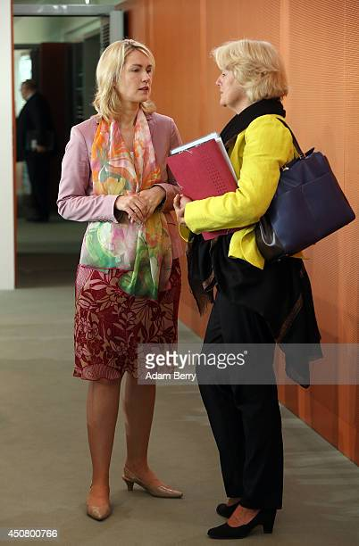 Family Minister Manuela Schwesig and State Minister Monika Gruetters arrive for the weekly German federal Cabinet meeting on June 18 2014 in Berlin...