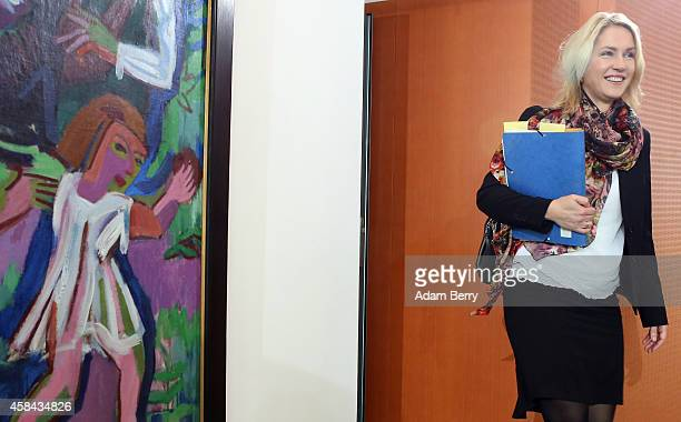 Family Minister Manuela Schwesig arrives for the weekly German federal Cabinet meeting on November 5 2014 in Berlin Germany High on the meeting's...