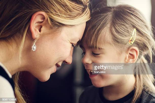Family moment between mother and daughter