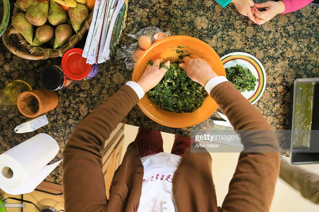 Family mother cooking at home in first person.