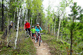 Father, son and daughter biking in Kananaskis, Alberta, Canada.