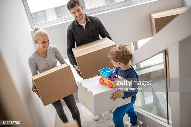 Family moving into new apartment