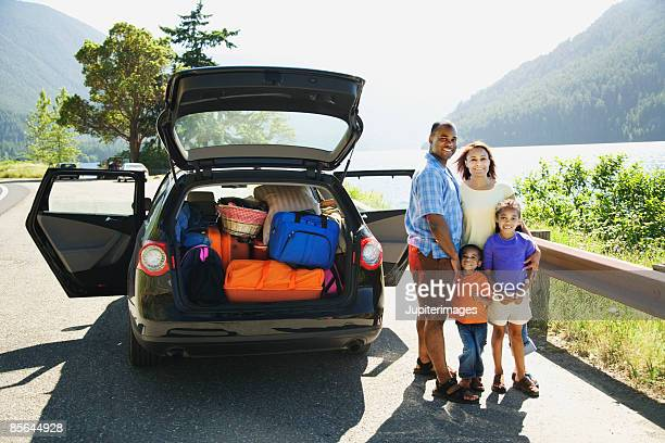 Family next to car