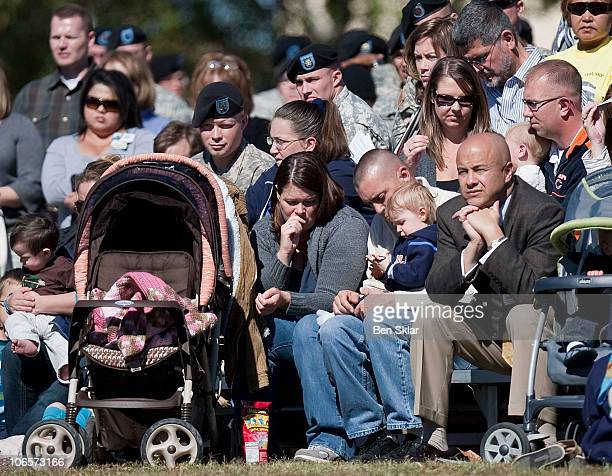 A family observes a moment of silence at a remembrance service honoring the 13 victims killed in the Ft Hood attacks on the one year anniversary in...