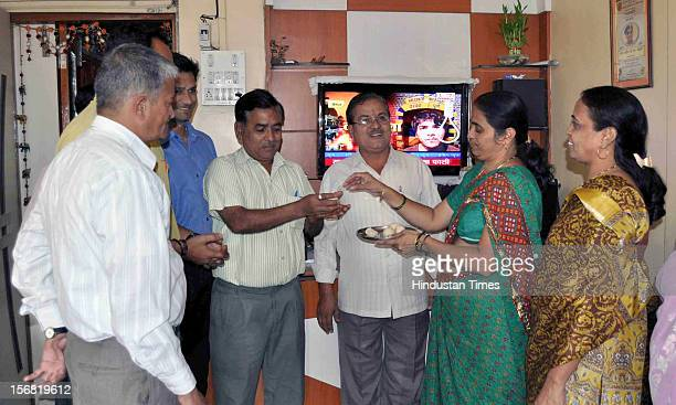 Family of 26/11 Martyr Head Constable Murlidhar Choudhary distribute sweets to celebrate the news of Ajmal Kasab's hanging on November 21 2012 in...