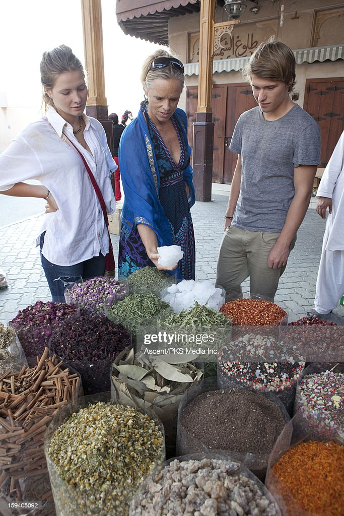 Family of 3 shop for spices in spice souk market : Stock Photo