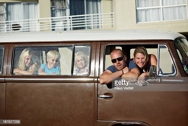 Family of 5 hanging out in old camper van