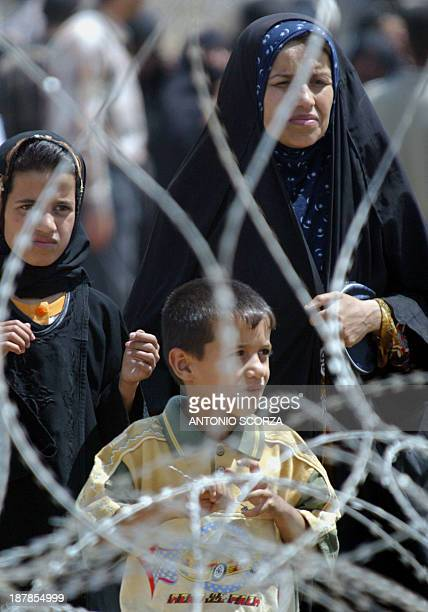 A family of an Iraqi detainee held at the Abu Ghraib prison 30 kms west of Baghdad waits at entrance of jail to have information about their loved...