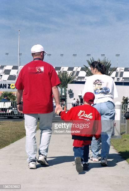 A family of Dale Earnhardt Jr fans walk toward the Fan Zone prior to the 2005 Daytona 500 on February 20 2005 at the Daytona International Speedway...
