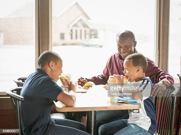 Family of father and two sons in restaurant