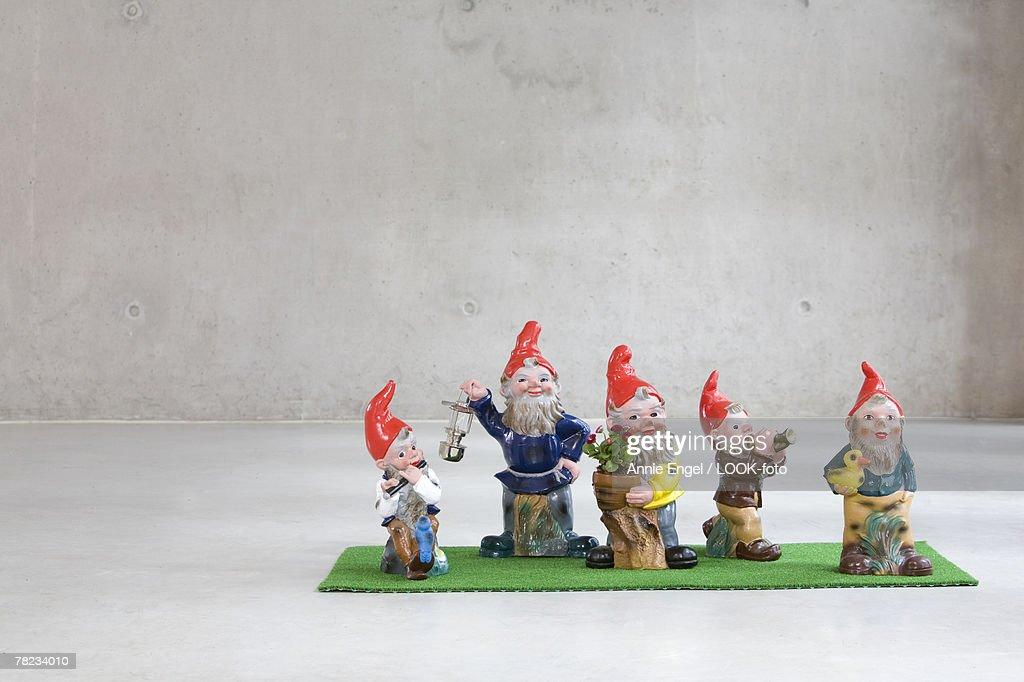 family of five garden gnomes