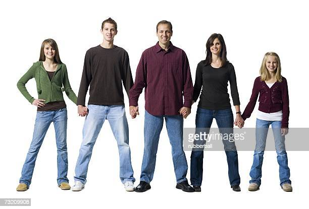 Family of five holding hands