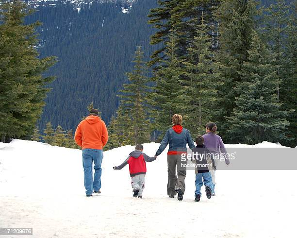 Family of five walking in snow