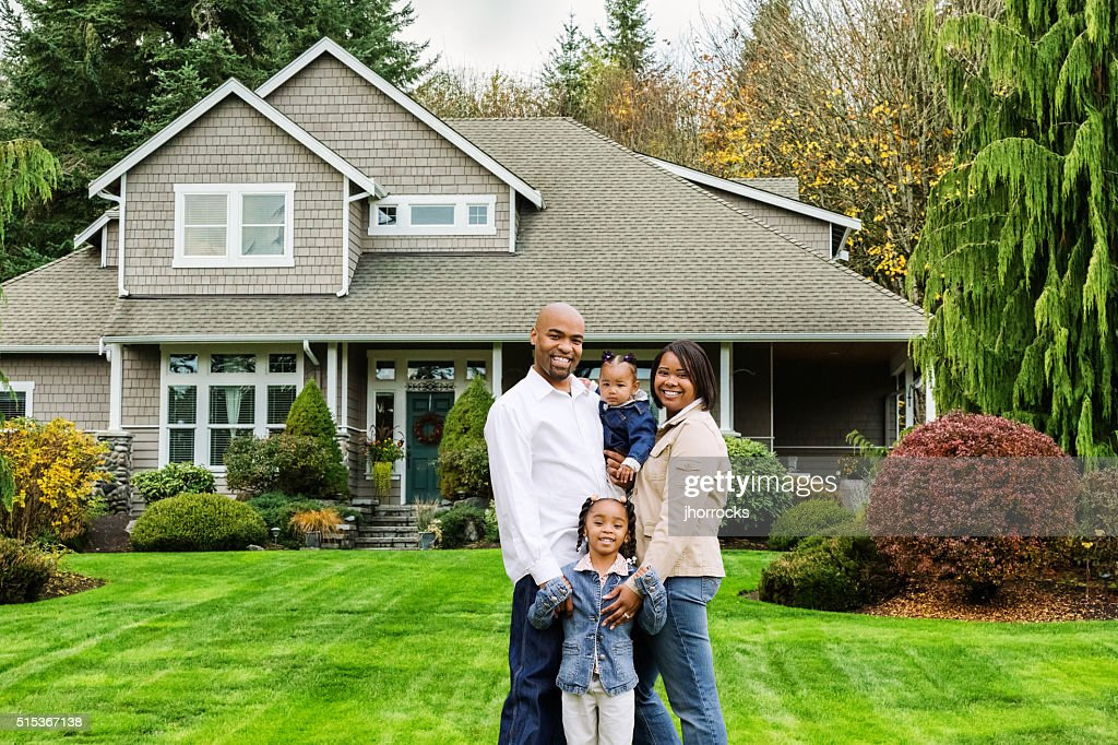 Family of Four at Home in Front Yard : Stock Photo