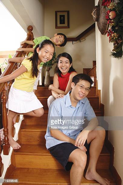 Family of four at home