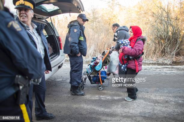 A family of four from Pakistan is arrested by RCMP officers after they illegally crossed the USCanada border near Hemmingford Quebec February 28 2017...