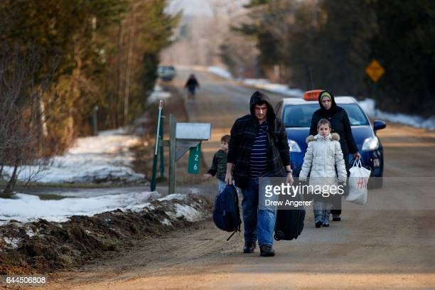 A family of four from Turkey arrives at the edge of Champlain New York to cross the USCanada border into Canada February 23 2017 in Hemmingford...