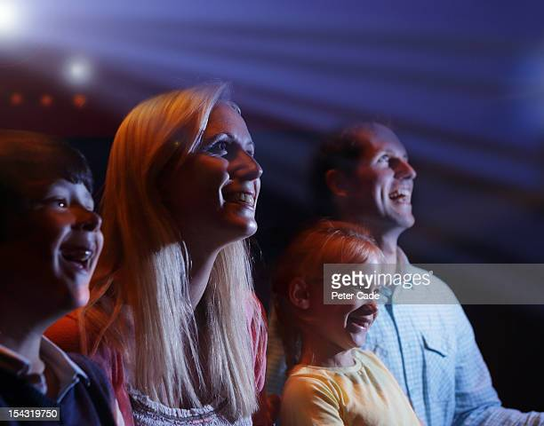 Family of four happy in cinema