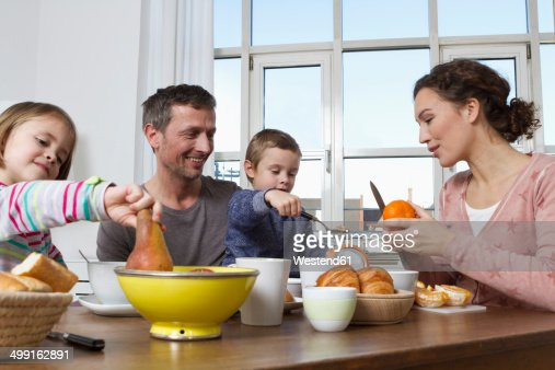 Family of four having healthy breakfast