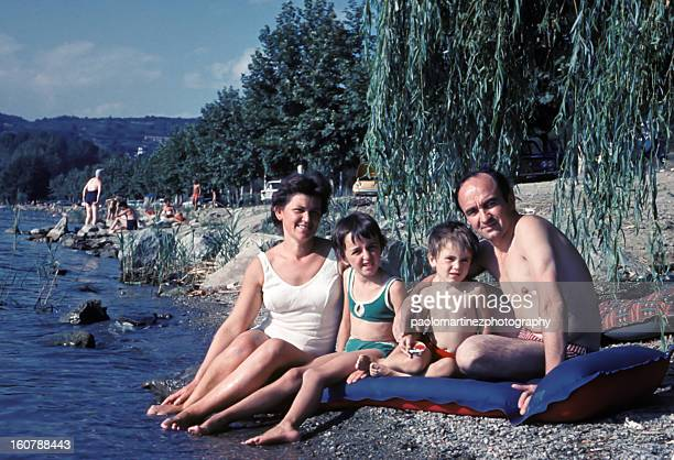 family of four in a bathing suit at the lake