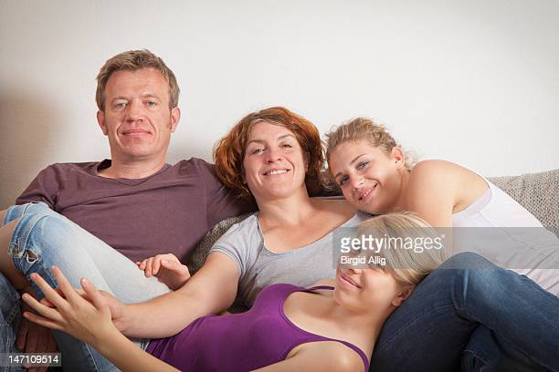 Family of four, portrait, smiling