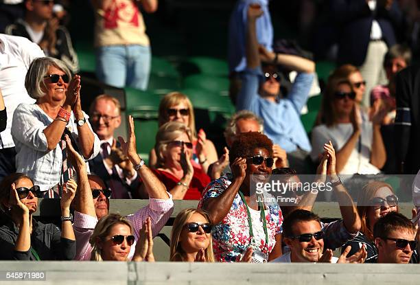 Family of Heather Watson of Great Britain watch on as Heather Watson of Great Britain and Henri Kontinen of Finland play during the Mixed Doubles...