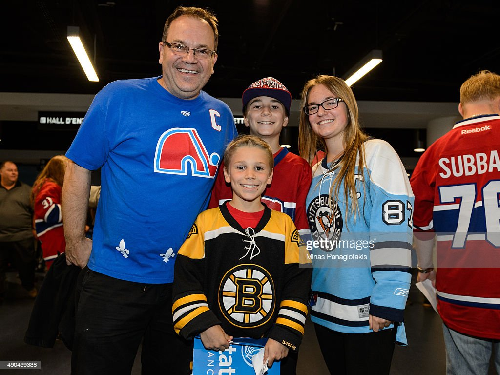 A family of hockey fans come out to support the NHL pre-season game between the Montreal Canadiens and the Pittsburgh Penguins at the Videotron Centre on September 28, 2015 in Quebec City, Quebec, Canada. The Montreal Canadiens defeated the Pittsburgh Penguins 4-1.