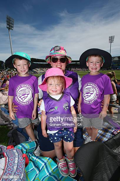 A family of Hurricanes fans show their support during the Big Bash League match between the Hobart Hurricanes and the Perth Scorchers at Blundstone...