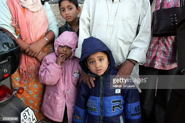 A family of illegal immigrants wait to be sent to a temporary holding center for foreign nationals June 10 2005 in Lampedusa Italy Lampedusa Island...