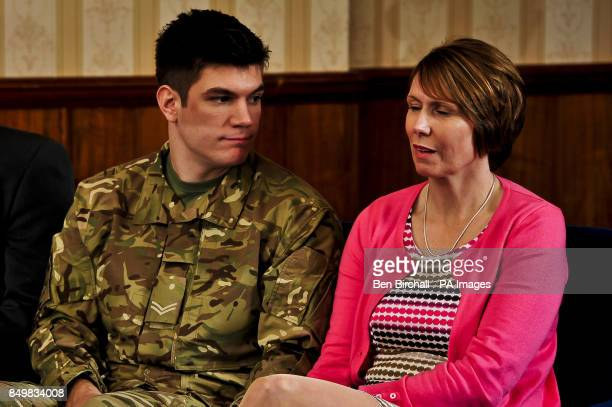 Family of Lance Corporal James Ashworth mum Kerry Ashworth and his brother and serving soldier Coran Ashworth react as James' citation is read out at...