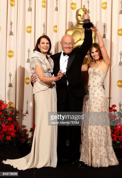 Family of late actor Heath Ledger father Kim Ledger mother Sally and sister Kate pose in the press room after accepting the award for Best Supporting...