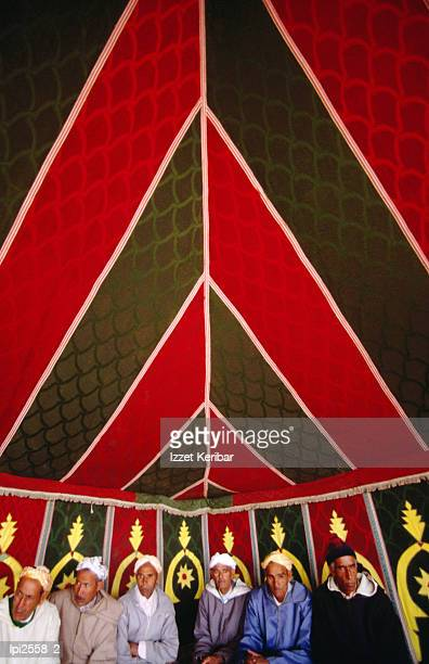 Family of men beneath tent, Front view, Meknes, Morocco